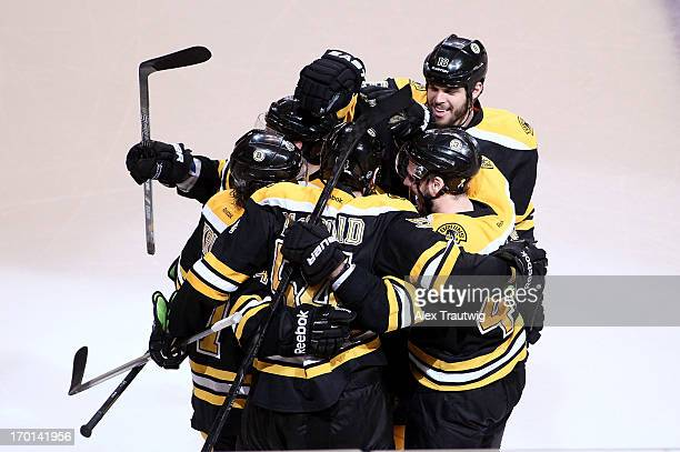 Adam McQuaid of the Boston Bruins celebrates with teammates after scoring a goal in the third period against the Pittsburgh Penguins in Game Four of...