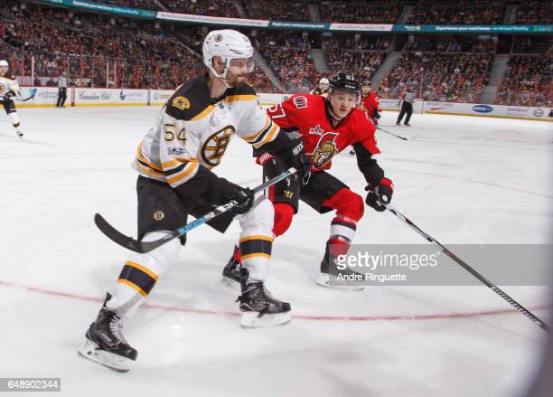 Adam McQuaid of the Boston Bruins defends against Tommy Wingels of the Ottawa Senators at Canadian Tire Centre on March 6 2017 in Ottawa Ontario...