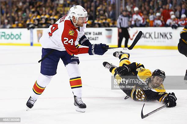 Adam McQuaid of the Boston Bruins dives after a shot by Brad Boyes of the Florida Panthers during the second period at TD Garden on March 31 2015 in...
