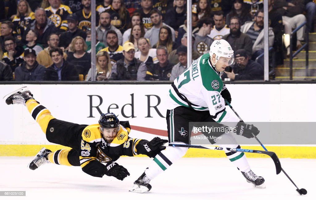 Adam McQuaid #54 of the Boston Bruins dives to defend Adam Cracknell #27 of the Dallas Stars during the second period at TD Garden on March 30, 2017 in Boston, Massachusetts.