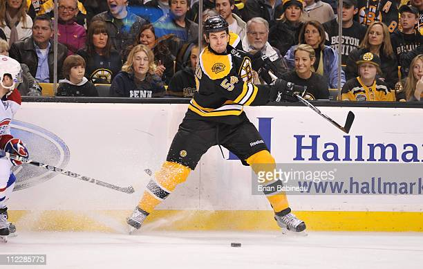 Adam McQuaid of the Boston Bruins passes the puck against the Montreal Canadiens in Game Two of the Eastern Conference Quarterfinals during the 2011...
