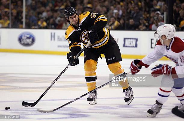 Adam McQuaid of the Boston Bruins passes the puck as Lars Eller of the Montreal Canadiens defends in Game One of the Eastern Conference Quarterfinals...