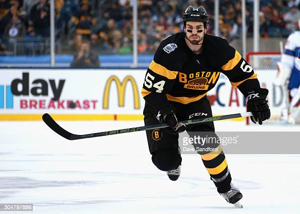 Adam McQuaid of the Boston Bruins plays against the Montreal Canadiens in the 2016 Bridgestone NHL Classic at Gillette Stadium on January 1 2016 in...