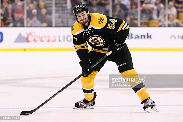 Adam McQuaid of the Boston Bruins takes a shot against the Detroit Red Wings during the first period at TD Garden on April 7 2016 in Boston...