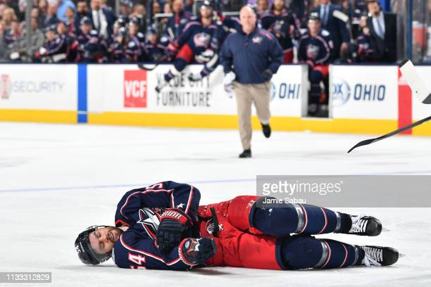 Adam McQuaid of the Columbus Blue Jackets lies on the ice following a check during the second period of a game against the Montreal Canadiens on...