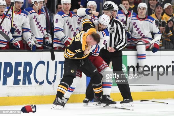 Adam McQuaid of the New York Rangers fights against Chris Wagner of the Boston Bruins at the TD Garden on January 19 2019 in Boston Massachusetts