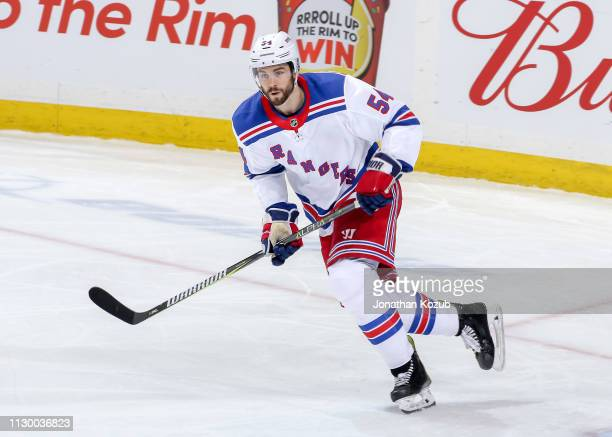Adam McQuaid of the New York Rangers follows the play up the ice during second period action against the Winnipeg Jets at the Bell MTS Place on...