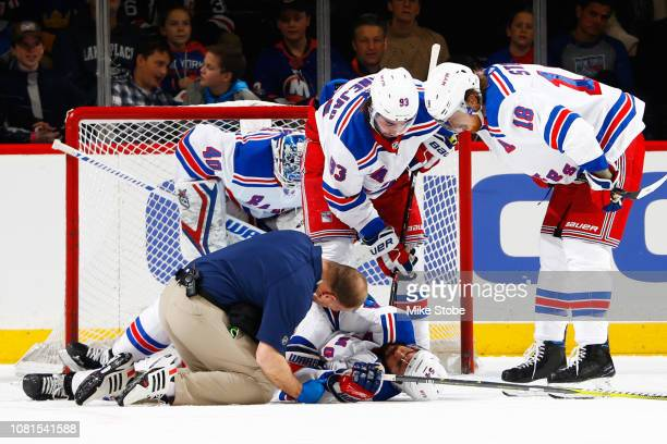 Adam McQuaid of the New York Rangers receives medical attention at Barclays Center on January 12 2019 the Brooklyn borough of New York City