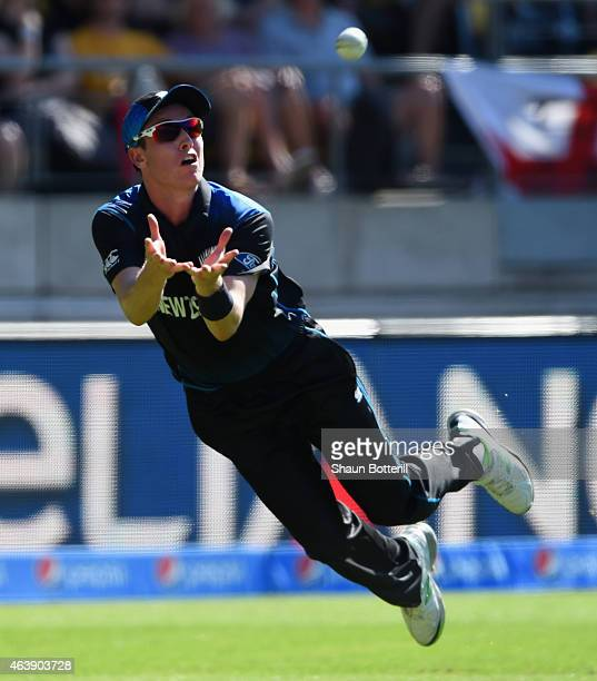 Adam Milne of New Zealand catches England captain Eoin Morgan during the 2015 ICC Cricket World Cup match between England and New Zealand at...