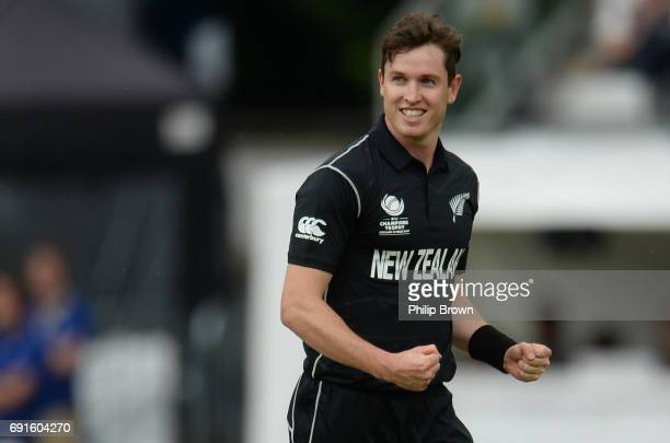 Adam Milne of New Zealand celebrates after dismissing Aaron Finch of Australia during the ICC Champions Trophy match between Australia and New...