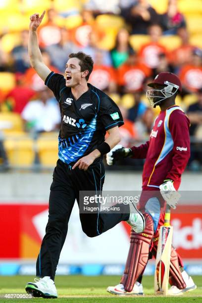 Adam Milne of New Zealand celebrates after taking the wicket of Chadwick Walton of the West Indies during the game two of the Twenty20 series between...