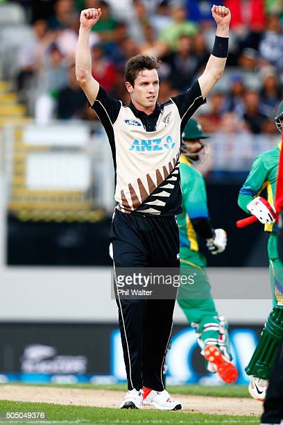 Adam Milne of New Zealand celebrates his wicket of Ahmed Shahzad of Pakistan during the first T20 match at Eden Park on January 15 2016 in Auckland...