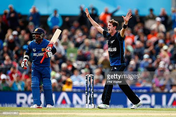Adam Milne of New Zealand celebrates his wicket of Jeevan Mendis of Sri Lanka during the 2015 ICC Cricket World Cup match between Sri Lanka and New...