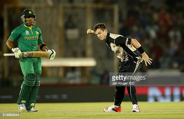 Adam Milne of New Zealand celebrates the wicket of Umar Akmal of Pakistan during the ICC World Twenty20 India 2016 Super 10s Group 2 match between...