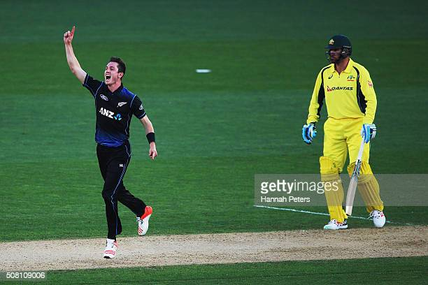 Adam Milne of the Black Caps celebrates the wicket of James Faulkner of Australia during the One Day International match between New Zealand and...