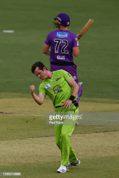 Adam Milne of the Thunder celebrates the wicket of Macalister Wright of the Hurricanes during the Big Bash League match between the Hobart Hurricanes...