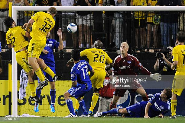Adam Moffat of the Columbus Crew and Steven Lenhart of the Columbus Crew collide with each other as they direct the ball to goalkeeper Jimmy Nielsen...