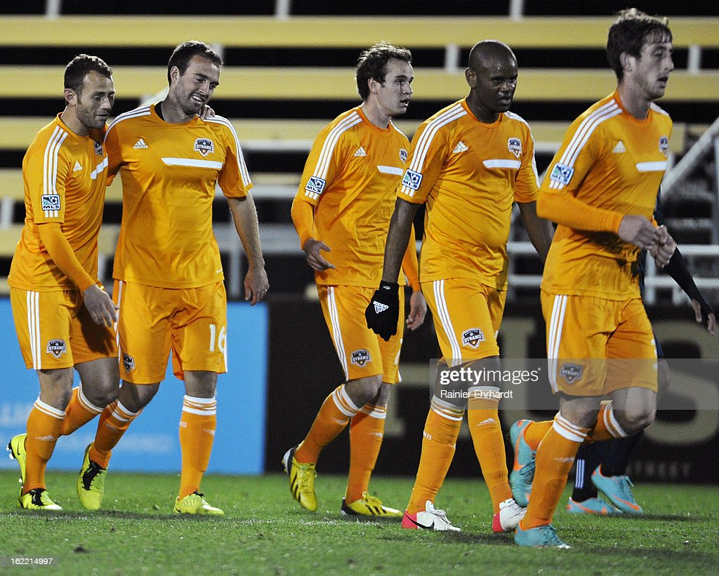 Adam Moffat #16 of the Houston Dynamo celebrates with teammate Brad Davis #11 after scoring a goal against the Vancouver Whitecaps FC during the second half of a game on February 20, 2013 in Charleston, North Carolina.