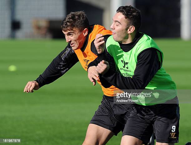 Adam Morgan and Iago Aspas of Liverpool FC take part in a training session at Melwood Training Ground on September 27 2013 in Liverpool United Kingdom