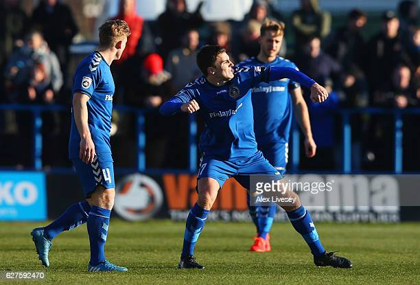 Adam Morgan of Curzon Ashton celebrates with team mates as he scores their first goal during the Emirates FA Cup second round match between Curzon...