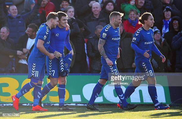 Adam Morgan of Curzon Ashton celebrates with team mates as he scores their third goal and completes his hat trick during the Emirates FA Cup second...