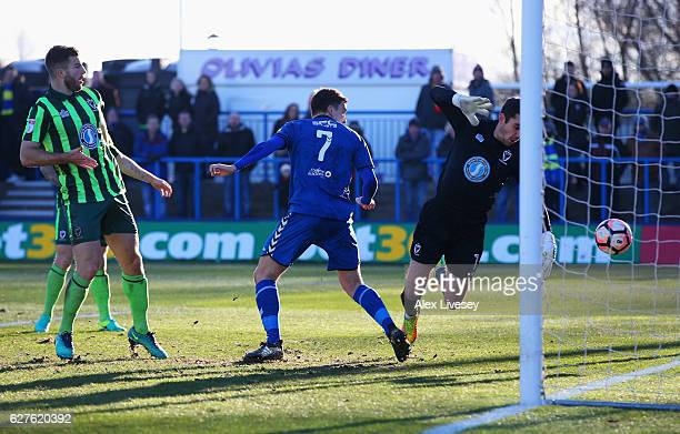 Adam Morgan of Curzon Ashton heads past goalkeper James Shea of AFC Wimbledon to score their second goal during the Emirates FA Cup second round...