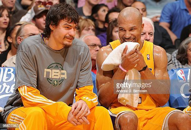 Adam Morrison and Derek Fisher of the Los Angeles Lakers laugh from the bench during the game against the Utah Jazz on April 2 2010 at Staples Center...