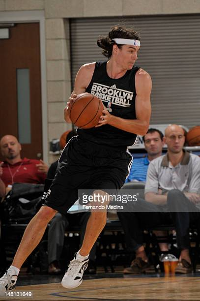Adam Morrison of the Brooklyn Nets drives against the Boston Celtics during the 2012 Air Tran Airways Orlando Pro Summer League on July 10 2012 at...
