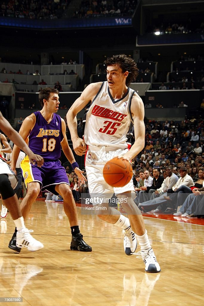 cee57e27b Adam Morrison of the Charlotte Bobcats drives around Sasha Vujacic ...