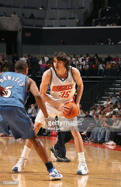 Adam Morrison of the Charlotte Bobcats looks to move against Antonio Daniels of the Washington Wizards during the preseason game at Charlotte Bobcats...