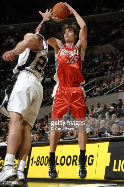 Adam Morrison of the Charlotte Bobcats shoots against Manu Ginobili of the San Antonio Spurs on November 15 2006 at the ATT Center in San Antonio...