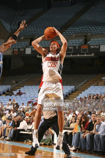 Adam Morrison of the Charlotte Bobcats shoots during the first half against the Washington Wizards on October 17 2006 at the Dean Smith Center in...