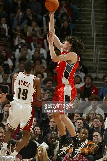 Adam Morrison of the Charlotte Bobcats shoots over Damon Jones of the Cleveland Cavaliers during the game at Quicken Loans Arena on December 13, 2006...