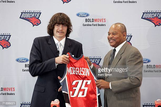 Adam Morrison of the Charlotte Bobcats shows off his jersey at the press conference with Head Coach Bernie Bickerstaff on June 29 2006 at the...