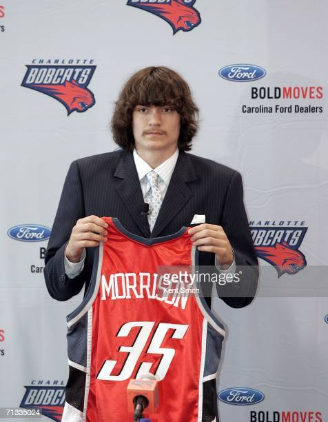 Adam Morrison of the Charlotte Bobcats shows off his jersey at the press conference on June 29 2006 at the Charlotte Bobcats Arena in Charlotte North...