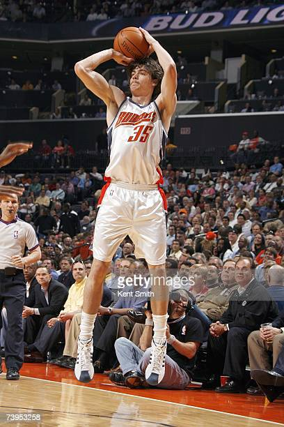 Adam Morrison of the Charlotte Bobcats takes a jump shot against the Cleveland Cavaliers at Charlotte Bobcats Arena on March 20 2007 in Charlotte...