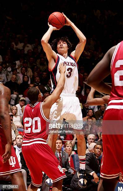 Adam Morrison of the Gonzaga Bulldogs attempts a shot against AJ Ratliff of the Indiana Hoosiers during the Second Round of the 2006 NCAA Men's...