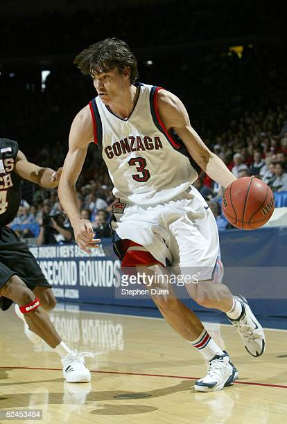 Adam Morrison of the Gonzaga Bulldogs dribbles against the defense of the Texas Tech Red Raiders during the first half of the second round of the...
