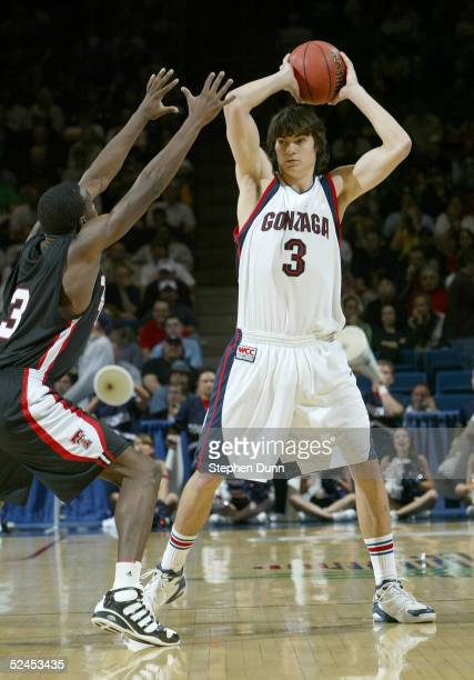 Adam Morrison of the Gonzaga Bulldogs moves against the defense of the Texas Tech Red Raiders during the first half of the second round of the NCAA...