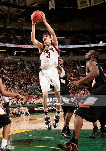 Adam Morrison of the Gonzaga Bulldogs shoots against the Oklahoma State Cowboys at Key Arena on December 10, 2005 in Seattle, Washington.