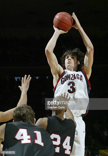 Adam Morrison of the Gonzaga Bulldogs shoots over the defense of the Texas Tech Red Raiders during the first half of the second round of the NCAA...