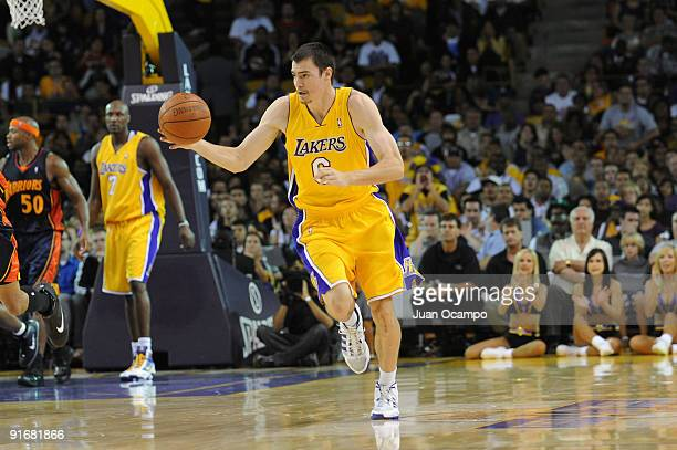 Adam Morrison of the Los Angeles Lakers dribble up court against the Golden State Warriors during a preseason game at The Forum on October 9 2009 in...