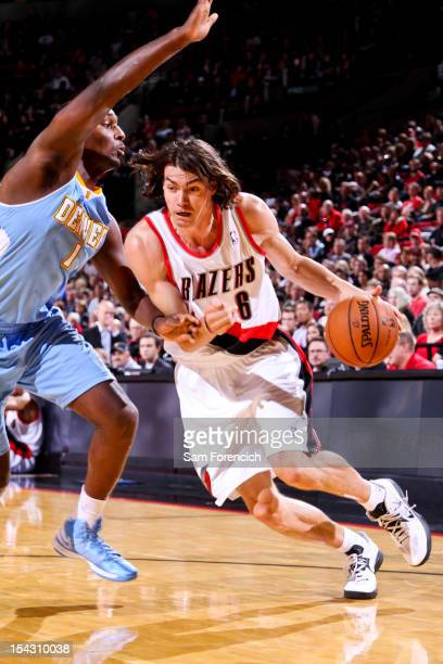 Adam Morrison of the Portland Trail Blazers drives against Jordan Hamilton of the Denver Nuggets during a preseason game on October 17 2012 at the...