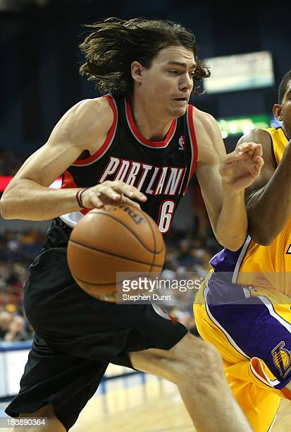 Adam Morrison of the Portland Trail Blazers drives against the Los Angeles Lakers at Citizens Business Bank Arena on October 10 2012 in Ontario...