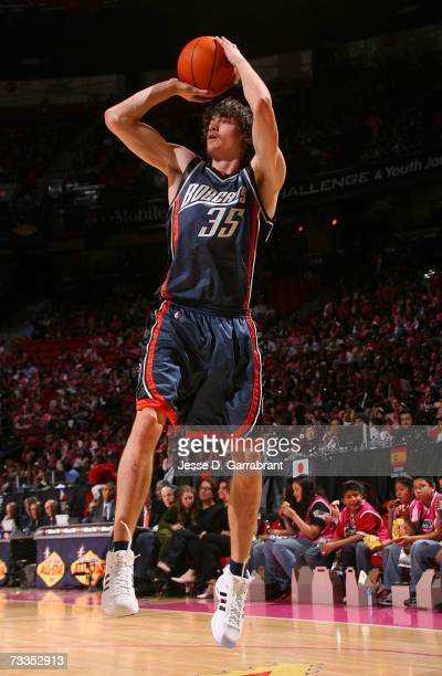 Adam Morrison of the Rookie Team attempts a shot against the Sophomore Team during the TMobile Rookie Challenge at NBA AllStar Weekend on February 16...