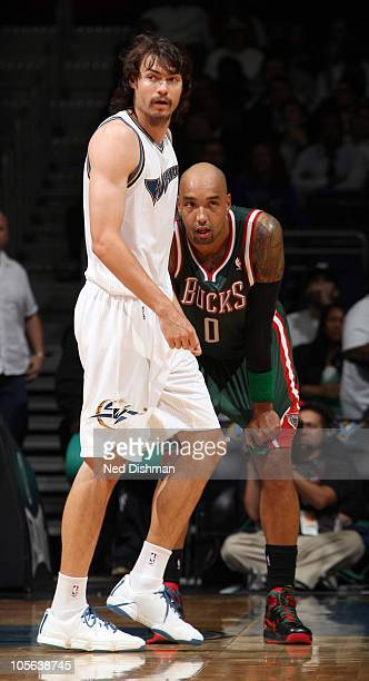 Adam Morrison of the Washington Wizards plays against Drew Gooden of the Milwaukee Bucks at the Verizon Center on October 14 2010 in Washington DC...