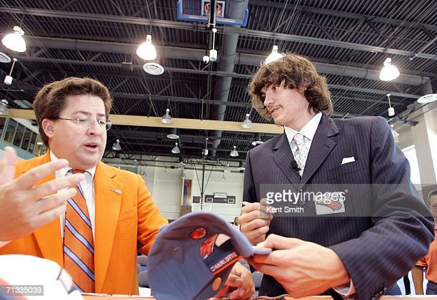 Adam Morrison signs autographs for a local charity after his Press Conference on June 29 2006 at the Charlotte Bobcats Arena in Charlotte North...