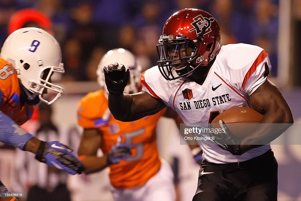 Adam Muema #4 of the San Diego State Aztecs runs the ball against the Boise State Broncos at Bronco Stadium on November 3, 2012 in Boise, Idaho.
