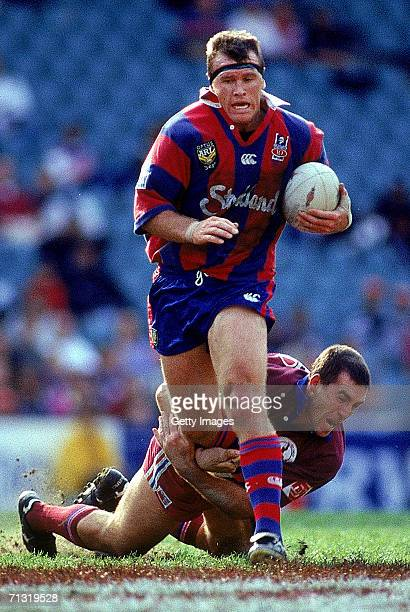 Adam Muir of the Knights is tackled by Daniel Gartner of the Sea Eagles during the ARL Final series match between the Newcastle Knights and the Manly...