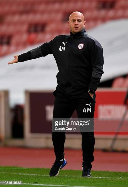 Adam Murray Caretaker Head Coach of Barnsley gives his team instructions during the Sky Bet Championship match between Stoke City and Barnsley at...
